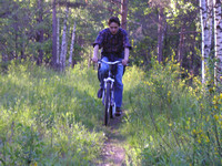 2004.06.12 Bicycle riding in a forest.