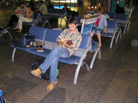 "2004.07.24 Reading in the departure hall of ""Sheremetive 2"" airport."