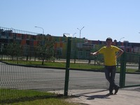 "2017.05.01 At the fence hiding the name of the colored building – ""Innopolis International School"" (Innopolis, Tatarstan, Russia)"