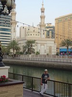 2018.05.31 An example of a harmonious combination of modern urban architecture with traditional religious one (mosques) along al Kasba channel in Sharjah.