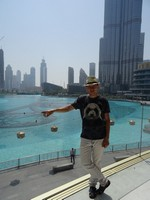 2018.06.01 At 2 p. m. the sun in the Emirates is so bright so it is hard to open eyes for a photograph in the Dubai fountains waiting for an evening.