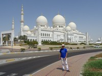2018.06.03 With Sheikh Zayed Grand Mosque in the background – one of the biggest mosques in the world, which we could not get into.