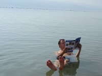 "2018.09.07 A ""classic"" photograph with reading on the water, which every visitor of the Dead Sea should take; the camera angle #1"