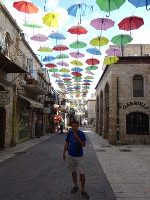 2018.09.07 Over the street of Yoel Moshe Salomon in Jerusalem there are colored umbrellas hanging, just like in the Portuguese city of Agueda in 2011 (where the tradition is from)