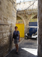 2018.09.08 Through the narrow streets of the Old City of Jerusalem you can move either on foot or by some mini transport like a golf car