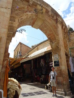 2018.09.09 Under the arch of the entrance to the Aftimos Market in the Muristan area of the Christian Quarter in the Old City of Jerusalem