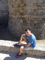 2019.05.31 Sitting at the foot of a tower of the Rhodes Fortress.