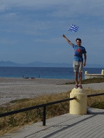 "2019.06.02 ""Statue"" with the Greek flag at the Northern end of the Rhodes with the confluence of the Aegean and Mediterranean seas."