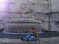 "2019.10.03 With the ""Adriatic Sea"" fountain (at the left part of the Vittoriano) in an imitating pose."