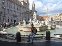 2019.10.03 Sitting on the fence of the Moor Fountain (Fontana del Moro) in Navona Square (Piazza Navona) in Rome.